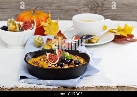 Baked oatmeal with pumpkin puree - Stock Photo