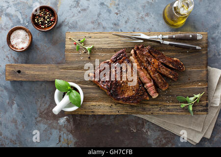 Ribeye steak on a cutting board top view - Stock Photo