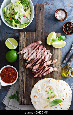 Cooking steak tacos with sliced meet - Stock Photo