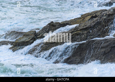 Sea crashing over rocks on Towan Headland in Newquay, Cornwall. - Stock Photo