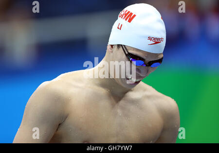 Rio De Janeiro, Brazil. 8th Aug, 2016. Li Zhuhao of China prepares prior to the men's 200m butterfly swimming heat - Stock Photo