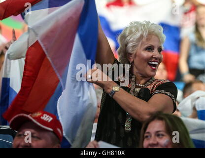 Rio De Janeiro, Brazil. 8th Aug, 2016. A Russian fan cheers during the women's sabre individual fencing event at - Stock Photo