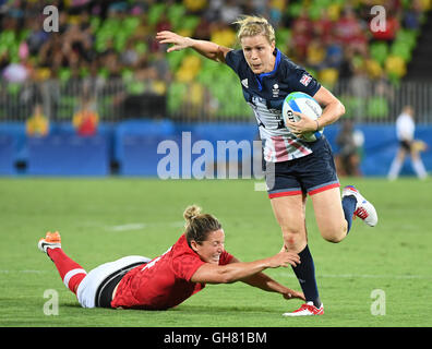 Rio De Janeiro, Brazil. 8th Aug, 2016. Kelly Russell (L) of Canada competes during the women's rugby sevens bronze - Stock Photo