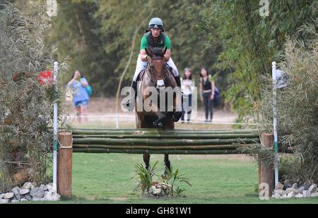 Rio de Janeiro, Brazil. 8th August, 2016. Fence 26. Mark Kyle (IRL) riding JEMILLA. Equestrian Eventing Cross Country - Stock Photo