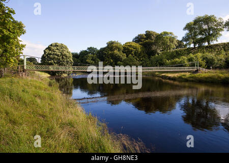 Suspension bridge over the River Wharfe near Hebden - Stock Photo