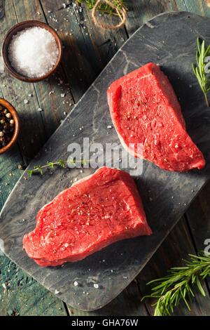 Raw Organic Grass Fed Sirloin Steak with Salt and Pepper - Stock Photo