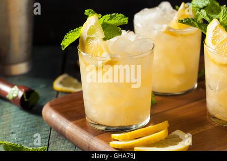 Homemade Boozy Bourbon Whiskey Smash with Lemon and Mint - Stock Photo