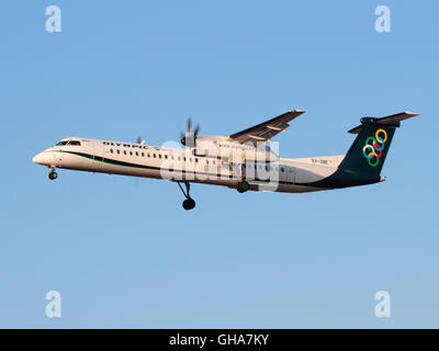 Olympic Air Bombardier Dash 8-Q400 turboprop regional airliner on approach at sunset - Stock Photo
