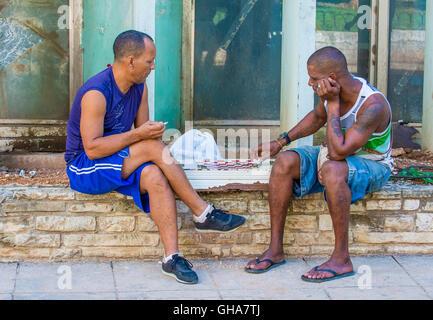 Unidentified men play Checkers on the street in Havana , Cuba. - Stock Photo