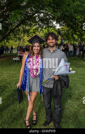 university student attending graduation ceremony at Sonoma State University in Rohnert Park in Sonoma County in - Stock Photo