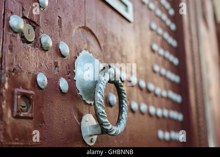 Doorknocker on brown wooden door, Morocco - Stock Photo