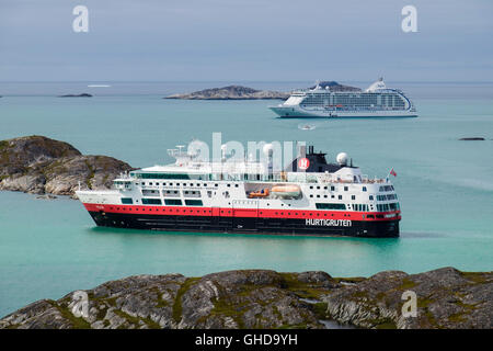 Visiting Hurtigruten explorer cruise ship MS Fram and cruise liner Seven Seas Voyager, anchored in Kuannersooq Fjord. - Stock Photo