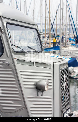 close up of vintage Citroen H van in front of boats in a marina