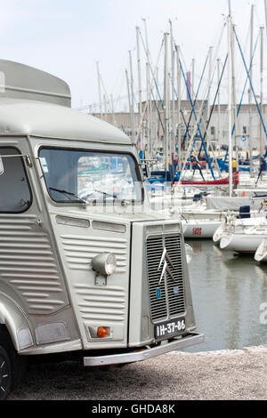 Citroen H van in front of boats in a marina - Stock Photo