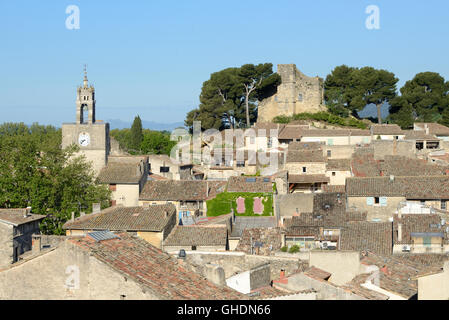 View over the Rooftops of the Village of Cucuron, and its Hilltop Dungeon,  Luberon Provence France - Stock Photo