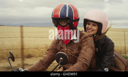 Young couple riding motorcycle in rural countryside - Stock Photo