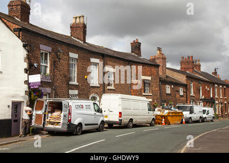 Several workmen, with white vans, offering various skills attentending  to flooded properties in the Lancashire - Stock Photo