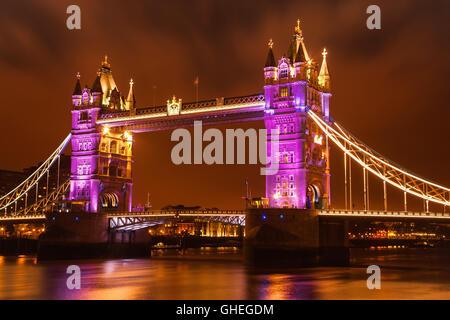 View of Tower Bridge festively illuminated. - Stock Photo