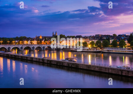 Maastricht and Maas River around sunset on summer evening - Stock Photo