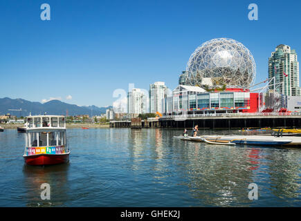 A view of an Aquabus and Science World at Telus World of Science on False Creek in Vancouver, British Columbia, - Stock Photo