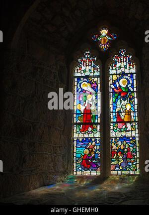 Light through a church stain glass window - Stock Photo