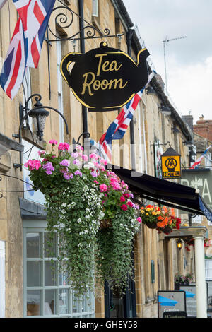 Hanging flower baskets outside Mrs T Potts Tearoom, Moreton in Marsh, Cotswolds, Gloucestershire, England - Stock Photo