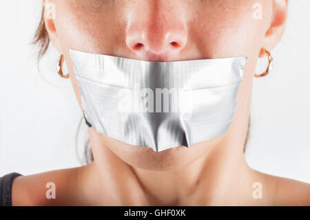 abducted woman with sealed mouth - Stock Photo