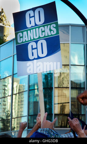 Vancouver Canucks Fans Cheering Game 2 NHL Stanley Cup Final in Downtown Vancouver, BC with 'Go Canucks Go' Banner Sign