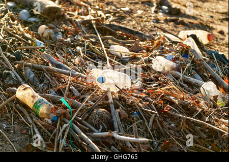 View of garbage mostly plastic bottles on a waterway in the industrial area of New Jersey - Stock Photo