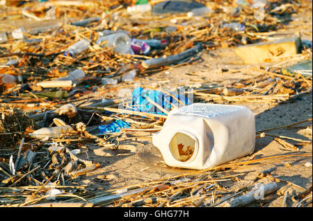 View of garbage with bottles at beach - Stock Photo