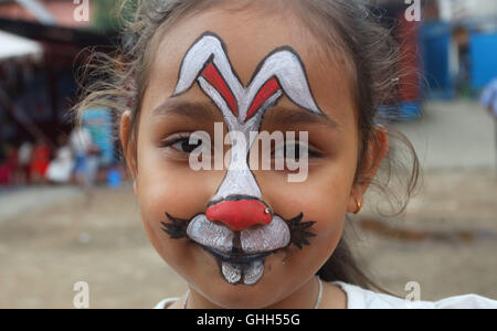 Kathmandu, Nepal. 14th Sep, 2016. A Nepalese kid gets her face painted during a celebration of the National Children's - Stock Photo