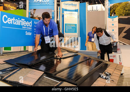 Las Vegas, Nevada, USA. 14th September, 2016. An exhibition staff shows how to install the household rooftop solar - Stock Photo