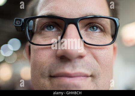 Duesseldorf, Germany. 28th Sep, 2016. A man wearing the webcam 'OrCam' on his glasses during the opening of the international care fair 'RehaCare' in Duesseldorf, Germany, 28 September 2016. The webcam is a reading assistant for blind and visually impaired people. It can read text out loud and recognise faces. The fair runs until 1 October 2016. PHOTO: WOLFRAM KASTL/dpa/Alamy Live News
