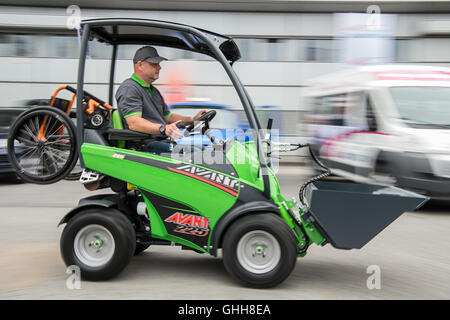 Duesseldorf, Germany. 28th Sep, 2016. Bert Pein driving a 'Handicap-Version' of the multi-fuctional forklift 'AVANT 225' by the Finish company 'Avant Tecno OY' during the opening of the international care fair 'Rheacare' in Duesseldorf, Germany, 28 September 2016. The fair runs until 1 October 2016. PHOTO: WOLFRAM KASTL/dpa/Alamy Live News