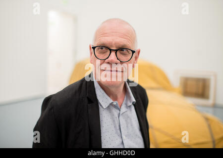Duesseldorf, Germany. 28th Sep, 2016. Museum director Beat Wismer pictured in the exhibition 'Hinter dem Vorhang, Verhüllung und Enthüllung seit der Renaissance - von Tizian bis Christo.' at the Museum Kunstpalast, in Duesseldorf, Germany, 28 September 2016. In the background is the installation 'Wrapped Beetle 1963 (Object 2014)' by Christo. The exhibition runs from 01.10.2016 until 22.01.2017. PHOTO: WOLFRAM KASTL/DPA/Alamy Live News