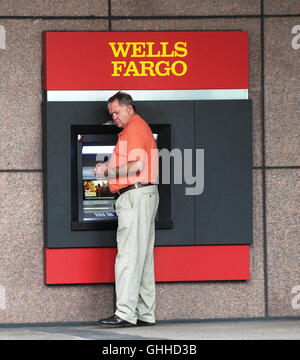 September 28, 2016 - Orlando, Florida, United States - A man uses an ATM at a Wells Fargo bank branch in Orlando, - Stock Photo