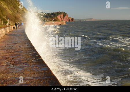 Waves crashing against the sea wall. - Stock Photo