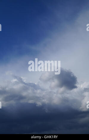 Calm summer blue sky with clouds - Stock Photo