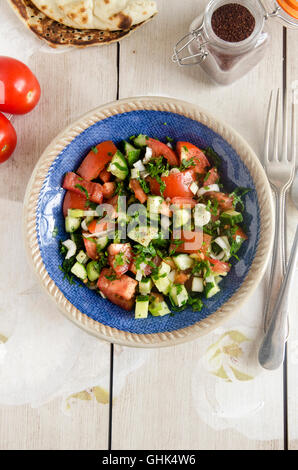 Tomato, cucumber, mint, and spring onion salad - Stock Photo