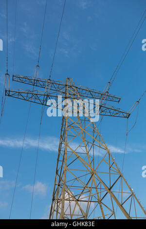 Electric overland power lines and  mast for energy transport. - Stock Photo