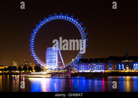 The London Eye on the South Bank of the River Thames at night. At a height of 135 meters, London Eye is the tallest - Stock Photo