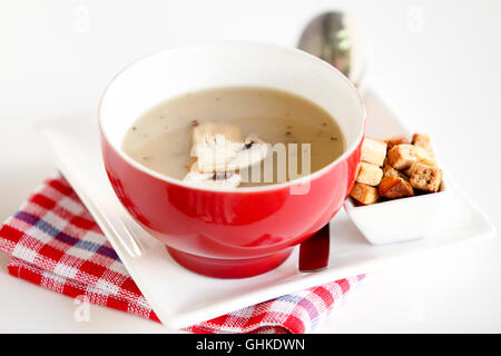 Cream of Mushroom Soup in red bowl - Stock Photo