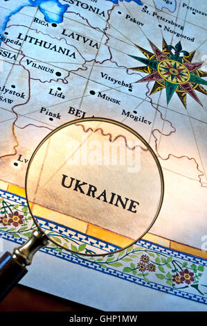 Old style map with magnifying glass over Ukraine featuring Latvia Lithuania Minsk & Eastern Europe - Stock Photo