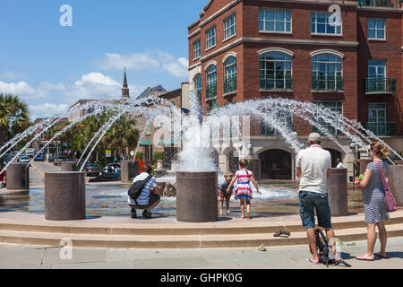 People enjoy one of the fountains in Waterfront Park in Charleston, South Carolina. - Stock Photo