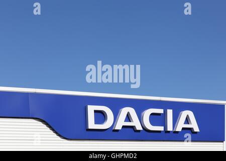Dacia logo on wall of a dealer - Stock Photo