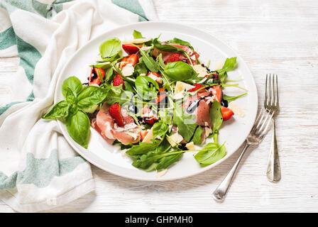 Summer arugula, prosciutto and strawberry salad - Stock Photo