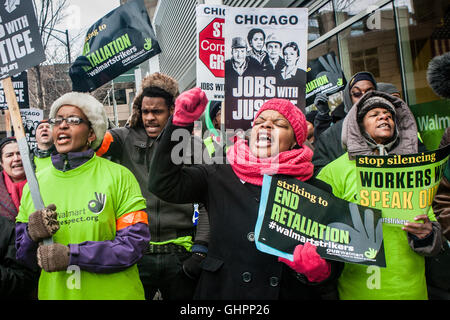 Chicago, Illinois - November 28, 2014: Striking Walmart workers and supporters protest outside a store on Black - Stock Photo