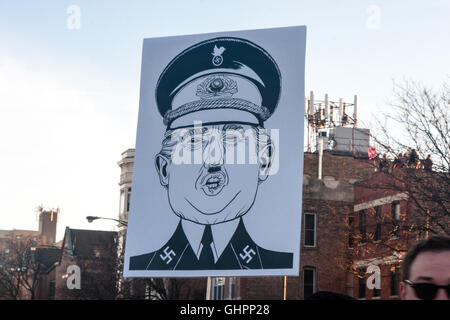 Chicago, Illinois - March 11, 2016: Anti-Trump protesters oppose Donald Trump's hate-speech outside the University - Stock Photo