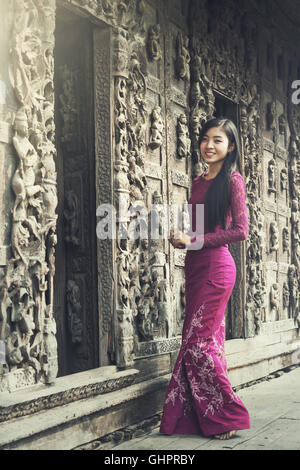 Burmese woman portrait in traditional dress. - Stock Photo