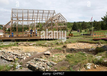 Timber frames outline the buildings that once stood on the Plantation Site at Cupids in Newfoundland and Labrador, - Stock Photo